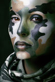 Beautiful young fashion woman with military style Stock Photo