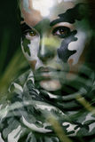 Beautiful young fashion woman with military style Stock Image