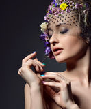Beautiful young fashion woman portrait with delicate flowers in Royalty Free Stock Photo