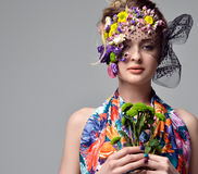 Beautiful young fashion woman portrait with delicate flowers Royalty Free Stock Image