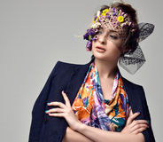 Beautiful young fashion woman portrait with delicate flowers Royalty Free Stock Photo