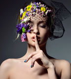 Beautiful young fashion woman portrait with delicate flowers  Royalty Free Stock Photography