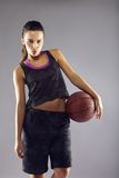 Beautiful young female basketball player Royalty Free Stock Photos