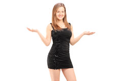 Beautiful young female in black dress gesturing with her hands Stock Photos