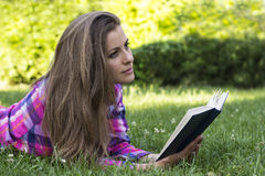 Beautiful young female with book in the hands Stock Image