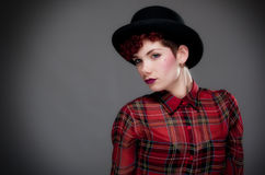 Beautiful young female in bowler hat and shirt Royalty Free Stock Photography