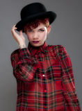 Beautiful young female in bowler hat and shirt Royalty Free Stock Images