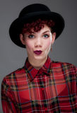 Beautiful young female in bowler hat and shirt Stock Images