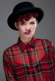Beautiful young female in bowler hat and shirt Royalty Free Stock Photo
