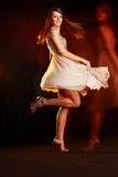 Beautiful young female dancing Royalty Free Stock Photos