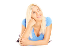 Beautiful young female daydreaming Stock Images
