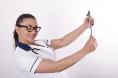 Beautiful young female doctor. Beautiful young and sexy female doctor with patient list Stock Photos