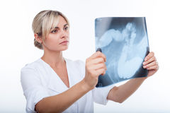 Beautiful young female doctor is analyzing human Royalty Free Stock Photo