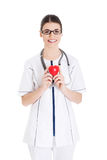 Beautiful young female doctor holding a heart. Royalty Free Stock Photography