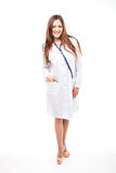 Beautiful young female doctor isolated on white with blue phonen Stock Image