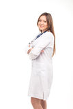 Beautiful young female doctor isolated on white with blue phonen Royalty Free Stock Images
