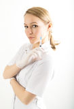 Beautiful young female doctor in medical gown and Royalty Free Stock Image