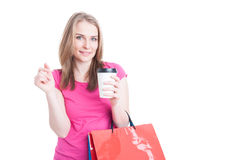 Beautiful young female doing shopping and drinking coffee Royalty Free Stock Photo