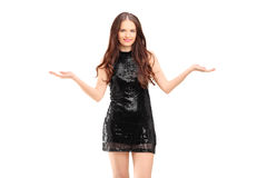 Beautiful young female in dress gesturing with her hands Stock Image