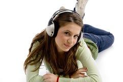 Beautiful young female enjoying music. With white background Stock Photos