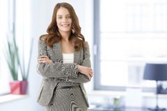 Beautiful young female executive smiling Royalty Free Stock Images