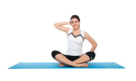 Beautiful young female exercising on a blue matt Stock Image