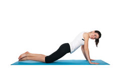 Beautiful young female exercising on a blue matt Stock Images