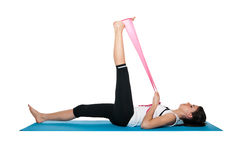 Beautiful young female exercising on a blue matt Royalty Free Stock Images