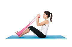 Beautiful young female exercising on a blue matt Royalty Free Stock Image
