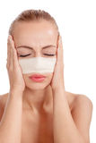Beautiful young female face with bandage on her nose - beauty t Royalty Free Stock Photos