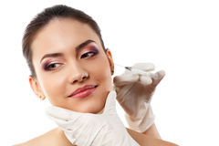 Beautiful young female face with beauty treatment Stock Images