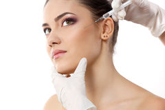 Beautiful young female face with beauty treatment Royalty Free Stock Images