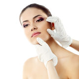 Beautiful young female face with beauty treatment Stock Image