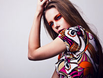 Beautiful young female face with bright fashion multicolored make-up. Stock Photos