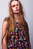 Beautiful young female face with bright fashion multicolored make-up. Royalty Free Stock Photography