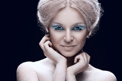 Beautiful young female face with bright fashion snow make-up Stock Photography