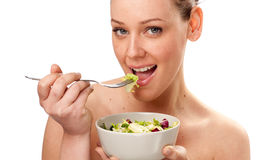 Beautiful young female face with fresh salad Stock Photography