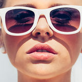 Beautiful young female face with sunglasses Stock Images