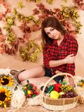 Beautiful young female farmer sitting in a hay with a harvest Stock Images