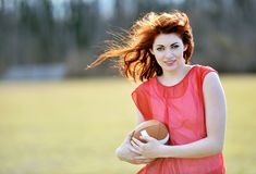 Beautiful young female football player Stock Images