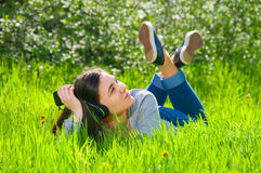 Beautiful young female girl listening to music on the player phone Royalty Free Stock Images
