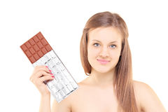 Beautiful young female holding a big chocolate Royalty Free Stock Photos