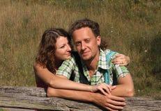 Beautiful young female hugging her boyfriend stock photos