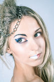 Beautiful young female with impudent make up Royalty Free Stock Images