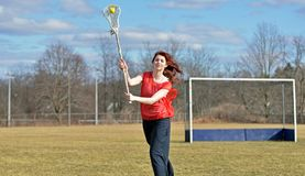 Beautiful young female lacrosse player Royalty Free Stock Photo
