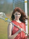 Beautiful young female lacrosse player Stock Photography