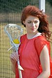 Beautiful young female lacrosse player Royalty Free Stock Image