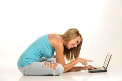 Beautiful young female with laptop Stock Photography