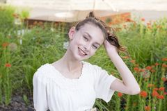 Brunette model in garden stock photos