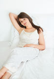 Beautiful young female lying on the bed Royalty Free Stock Photography
